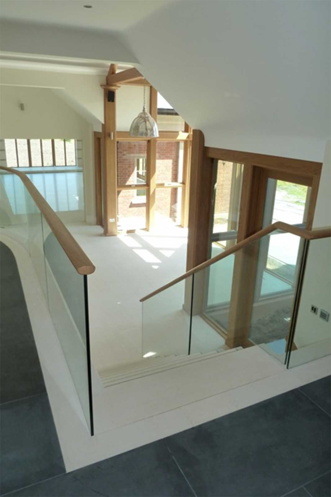 Frameless Glass Balustrade with Wooden Handrail