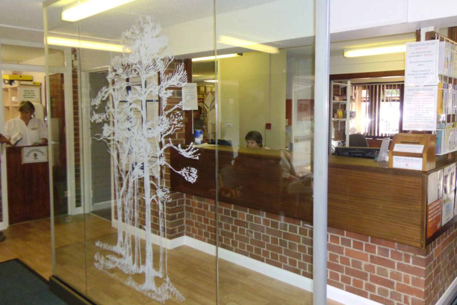 Bespoke Decorative Glass Screen with Tree Motif
