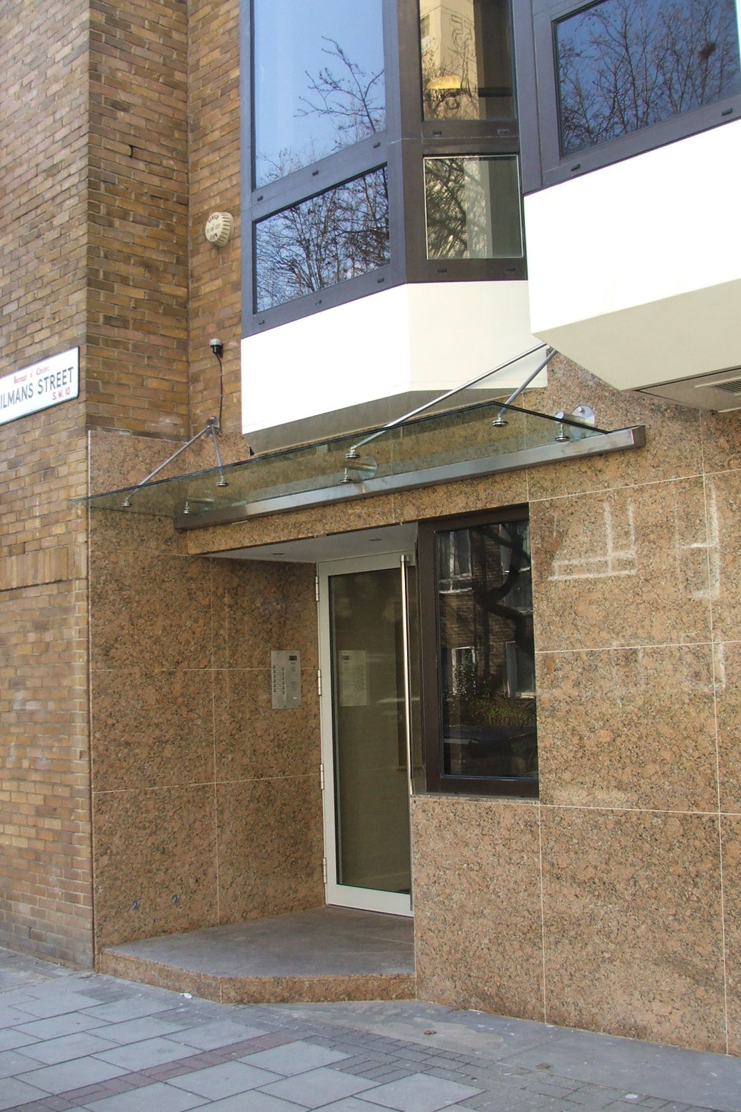 Frameless glass canopy with stainless steel fixings