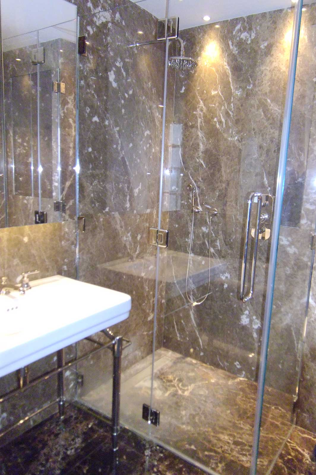 Bespoke Glass Shower Enclosure with chrome fixtures