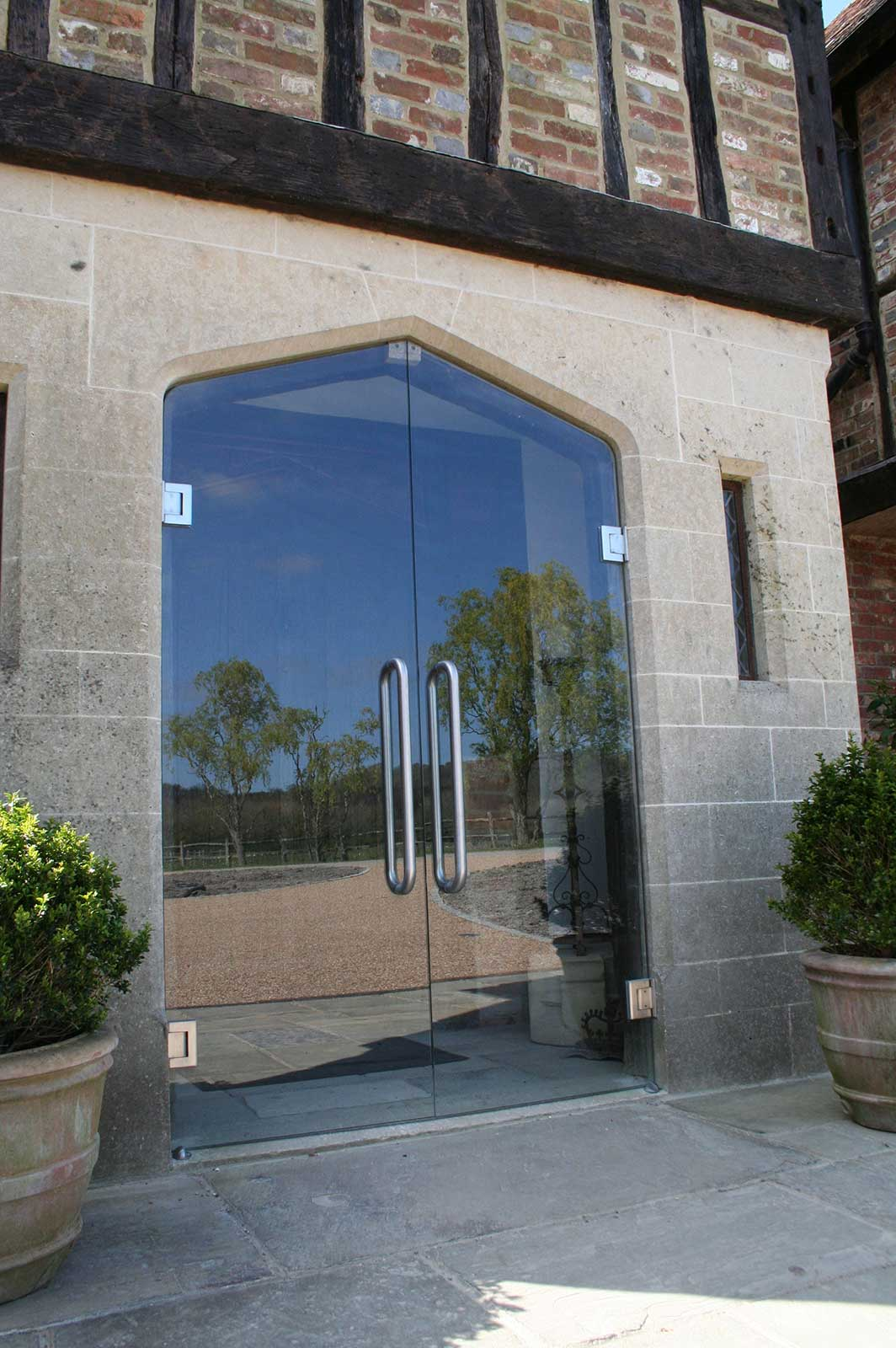 Bespoke Frameless Arched Glass Double Doors