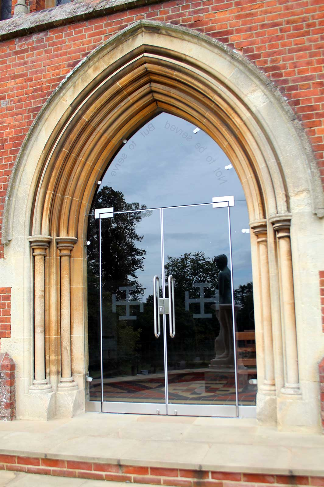 Heritage Building Glass Doors with Arched Surround