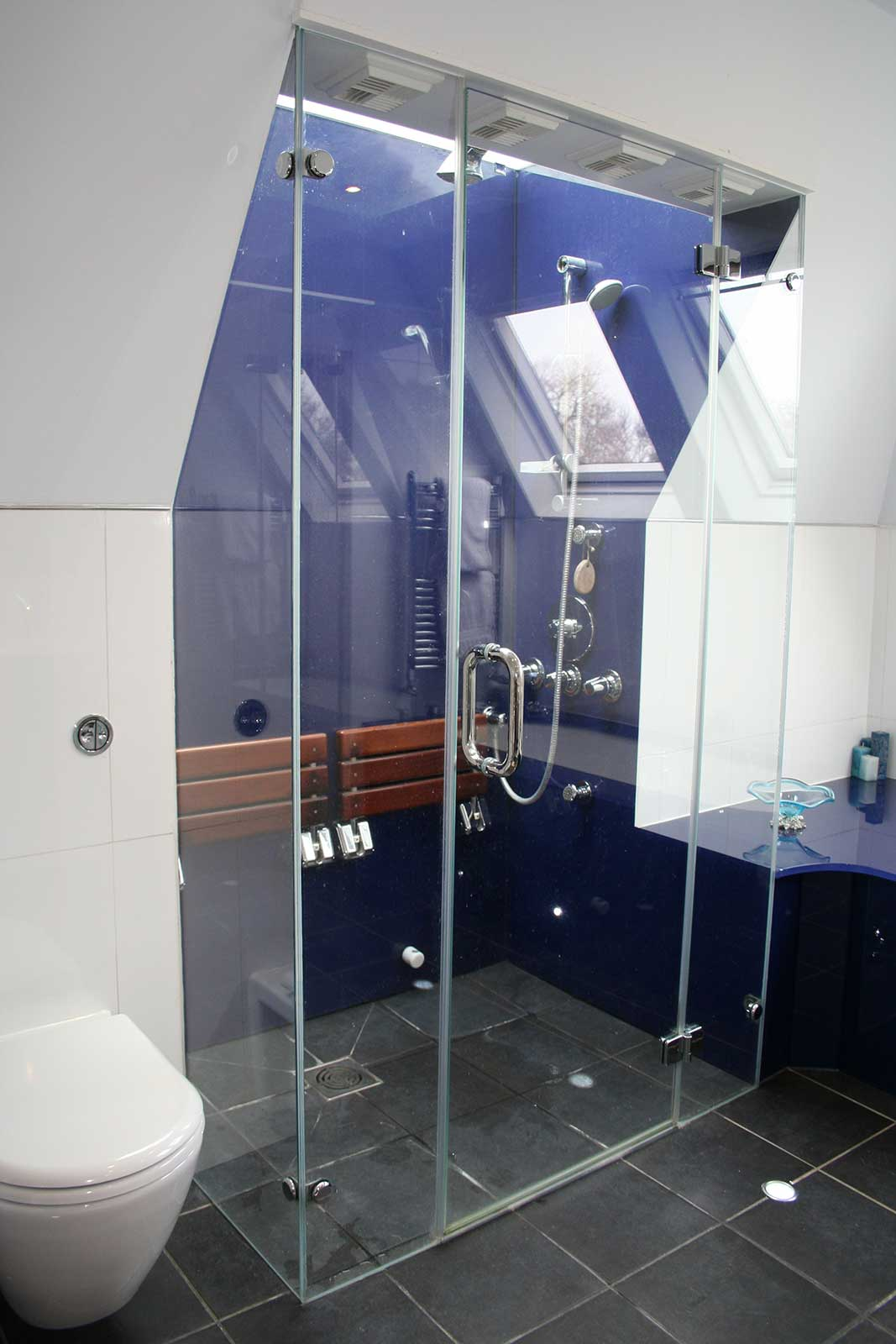 Bespoke Glass Wall Cladding with Frameless Shower Enclosure