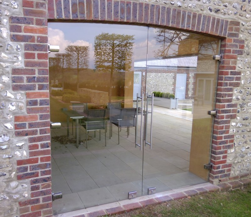 Large Glass Double Doors Fitted to Stonework