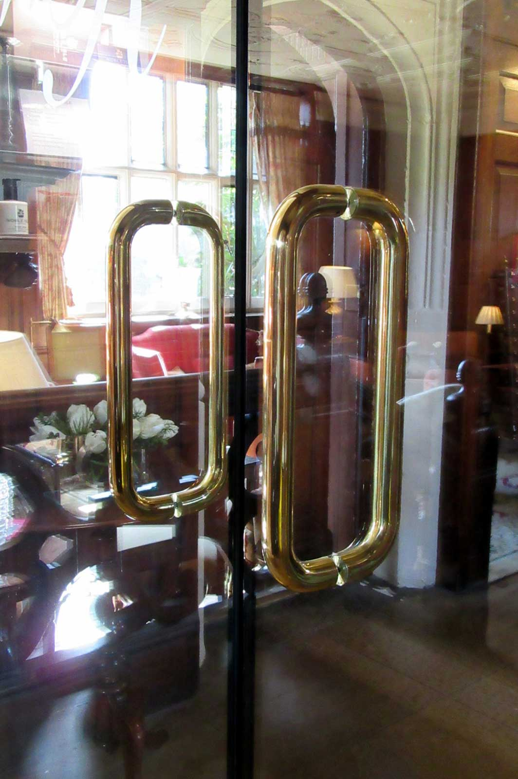 Custom Glass Fire Doors with Polished Brass Handles, Gravetye Manor