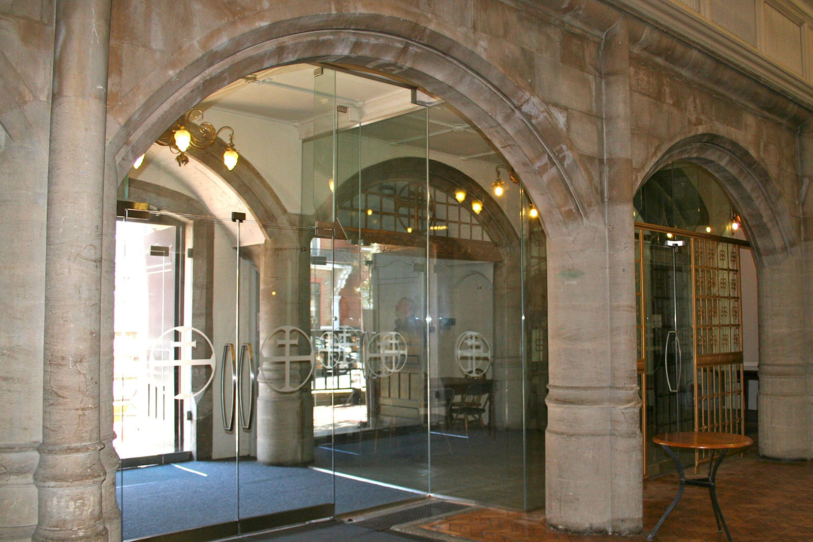 Arched Glass Doors and Screens with Applied Manifestation