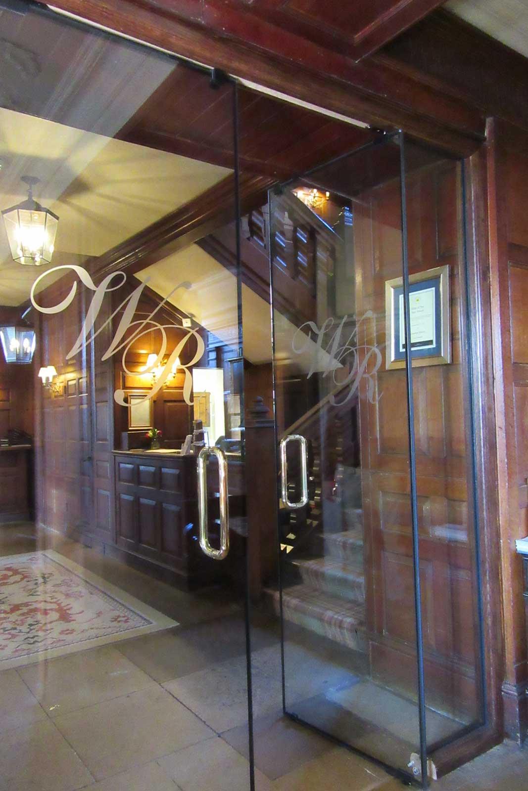 Gravetye Manor custom frameless fire rated doors