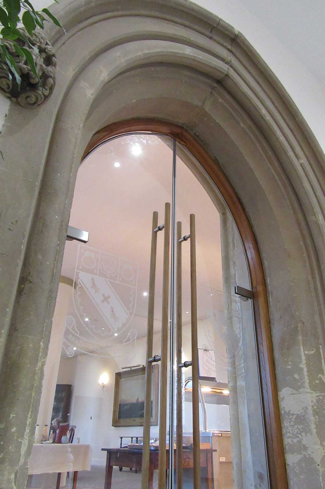 Arched Shaped Glass Doors set into Stone Arch, Lancing College
