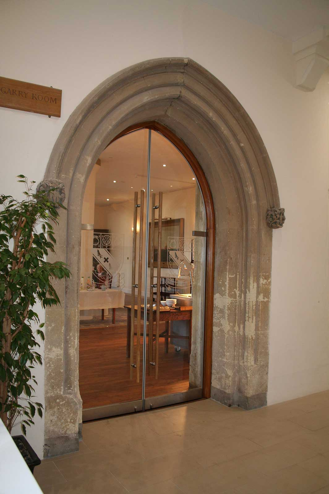 Custom Double Arched Glass Doors to the dining room