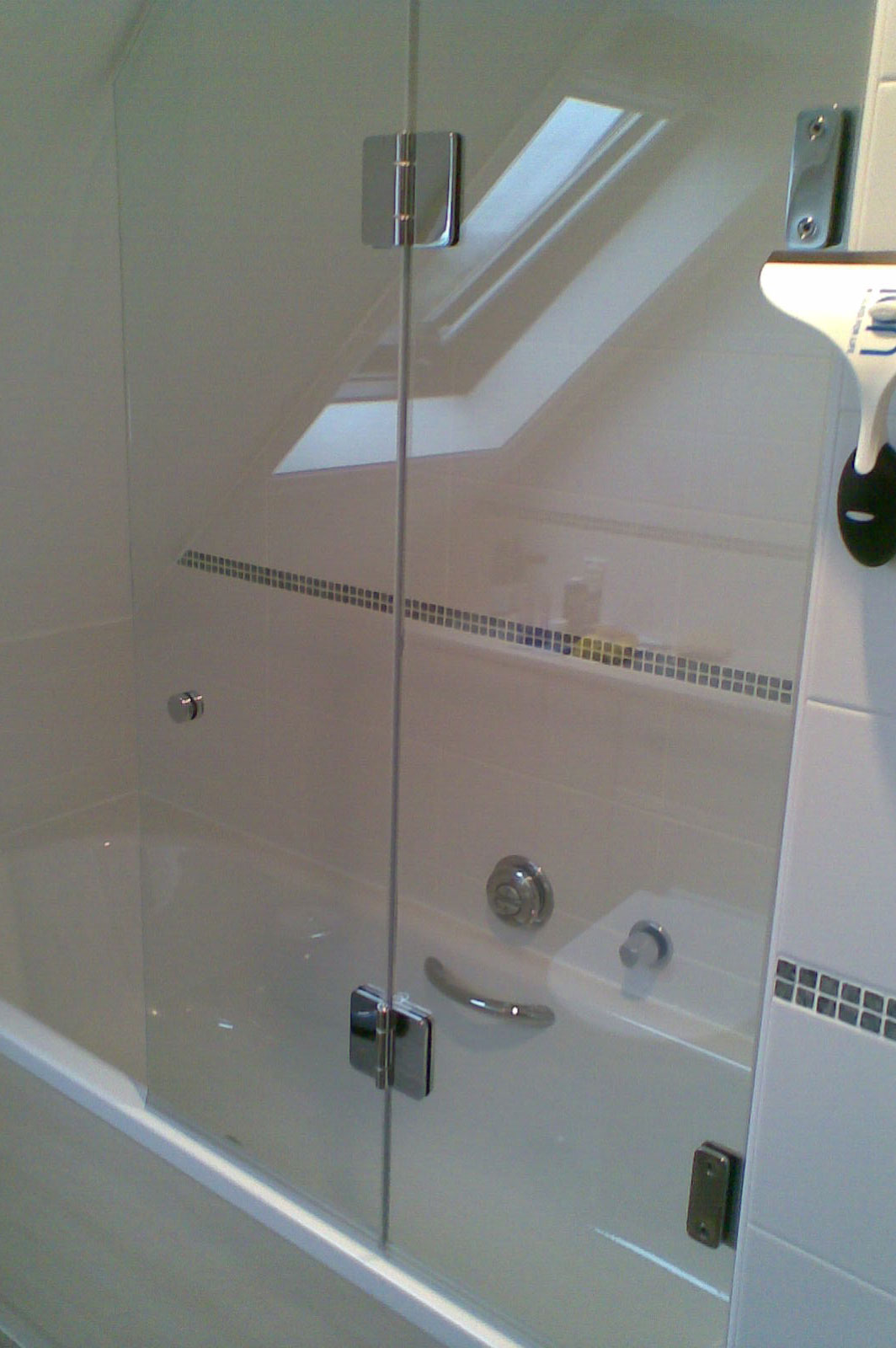 Custom Glass Bath Screen with Cutout for Sloping Ceiling