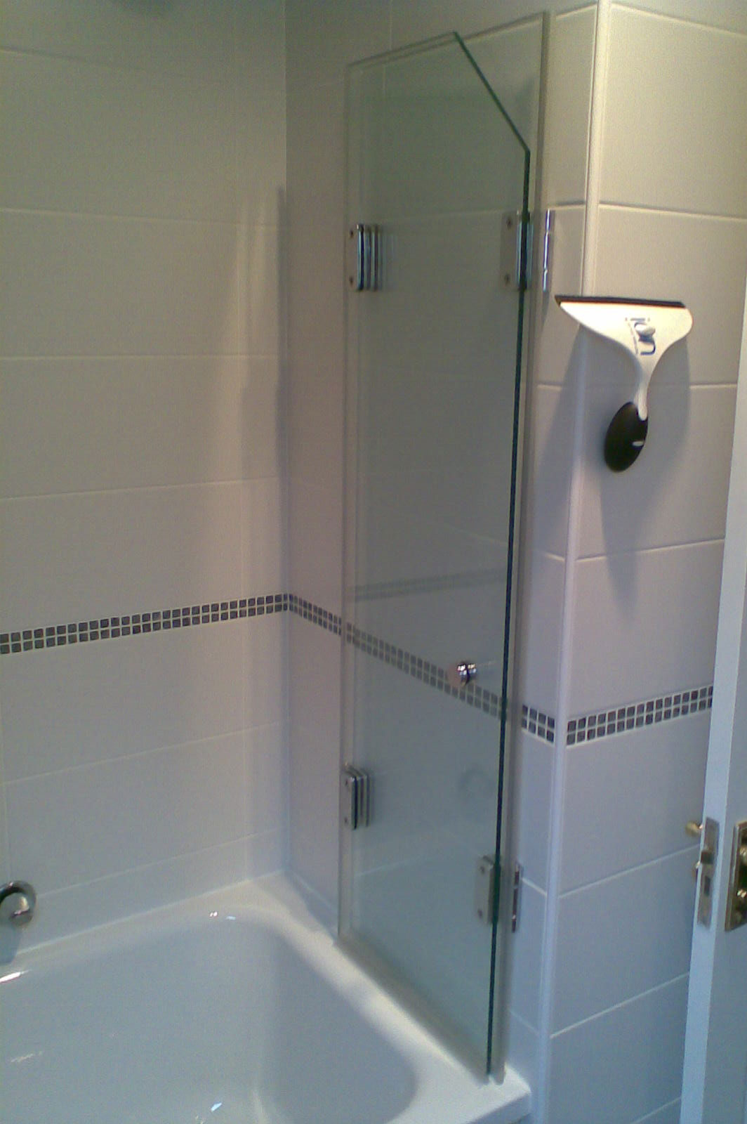 Bespoke Frameless Glass Bath Screen with Sloping Ceiling