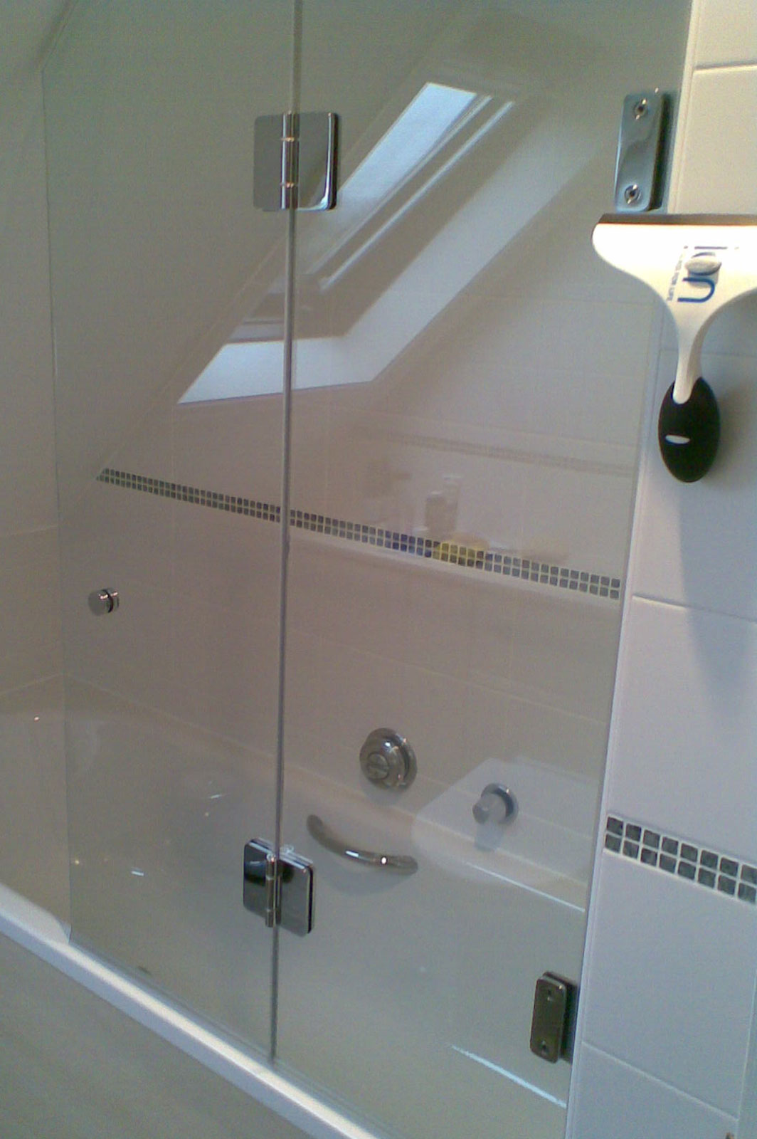 Bi-Folding Bath Screen with cutout for sloping ceiling