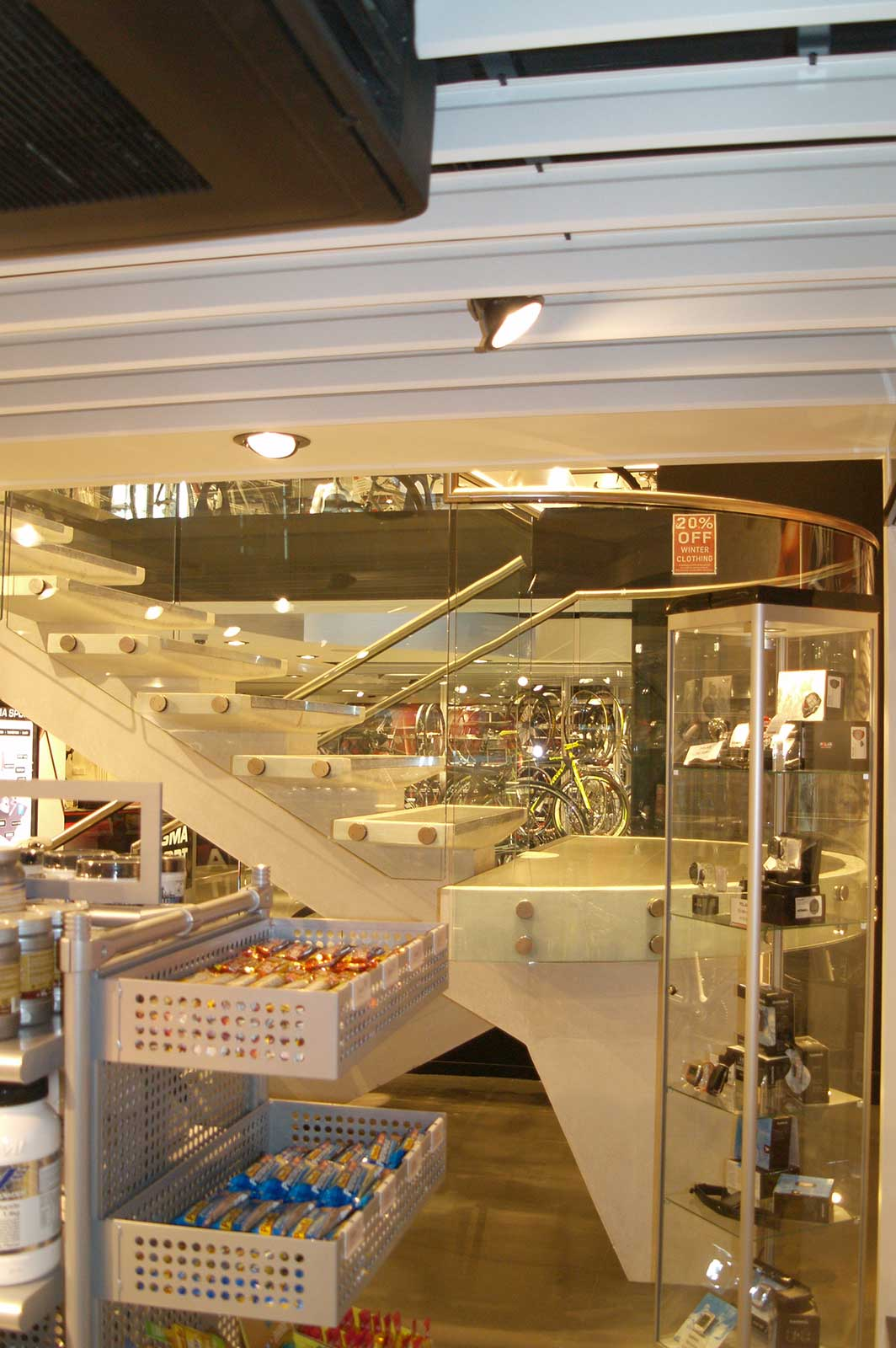Bolted Curved Glass Balustrade for retail space Sigma Sports