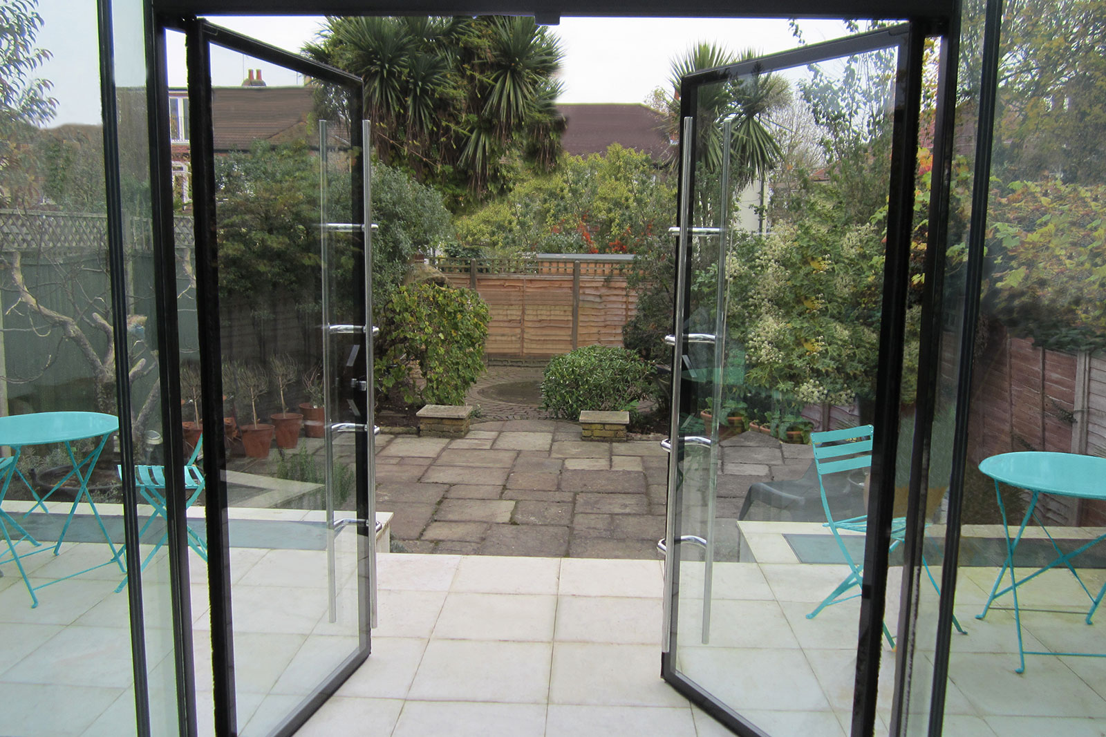 Frameless Glass Conservatory with Double Doors