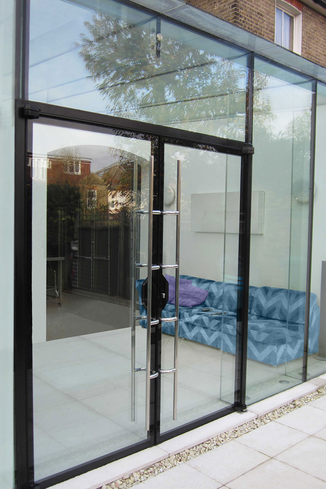 Structural Glass Box Extension with Double Doors