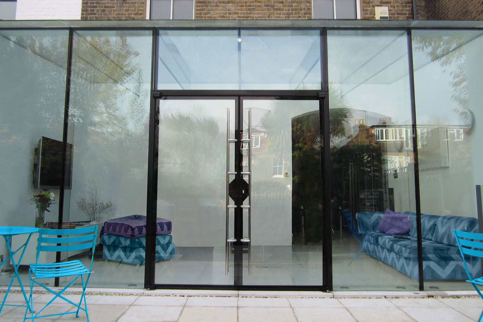 Double glass doors on structural glass extension