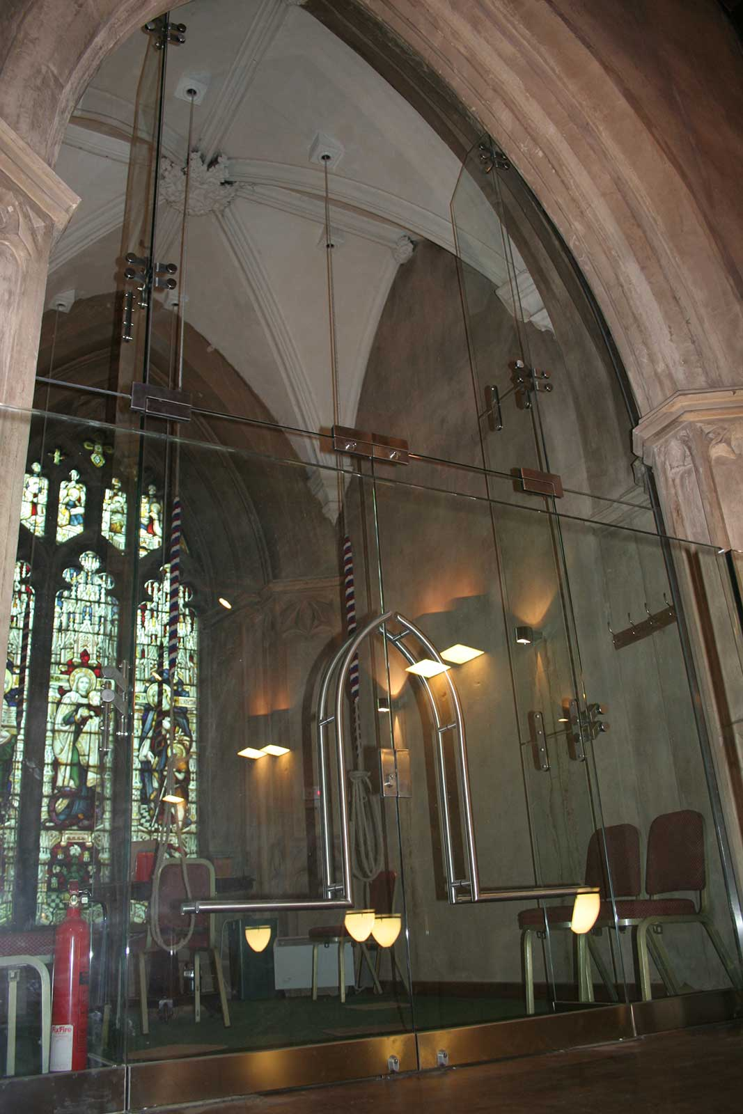 Frameless Glass Doors and Structural Screen set into church stonework