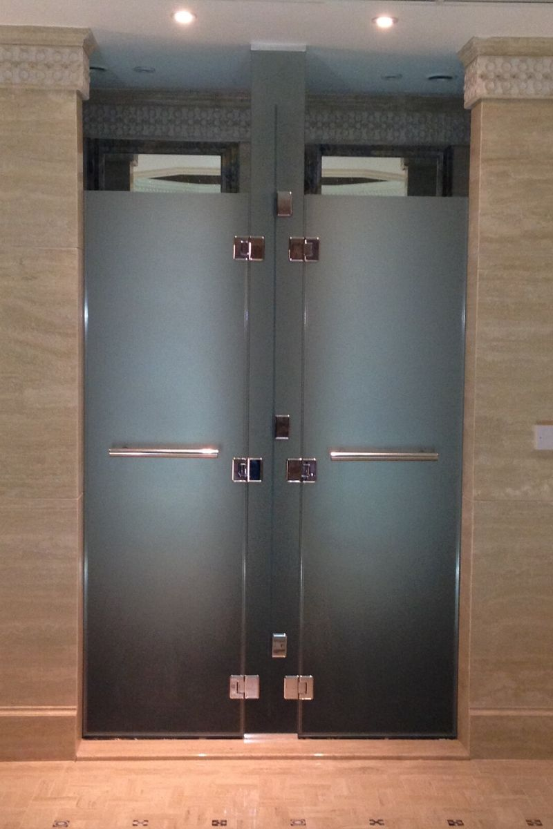 Sandblasted glass cubicles with stainless steel handles