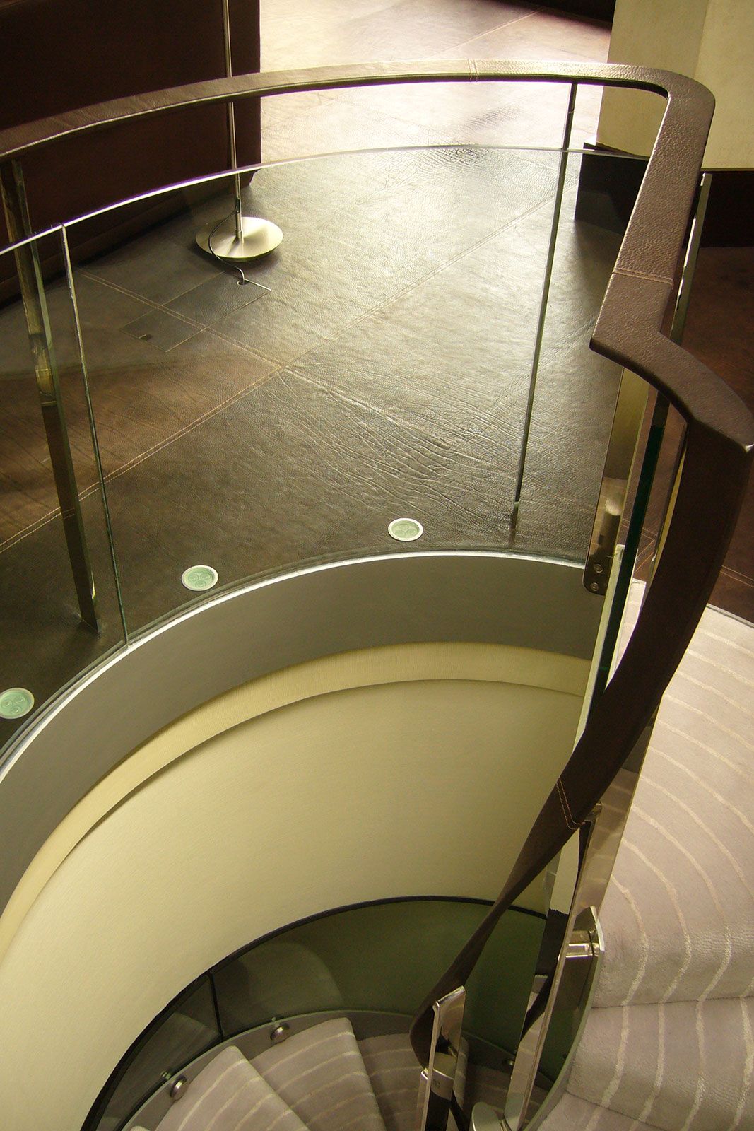 Curved Glass Balustrades with Leather Handrail