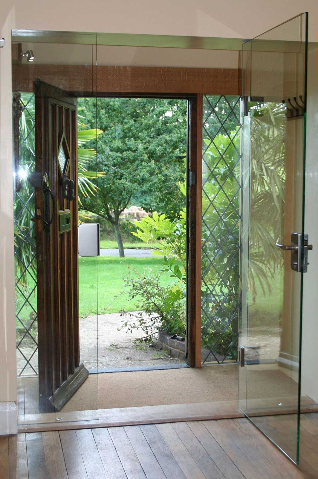 Secure Frameless Glass Door with Locks and Fixtures