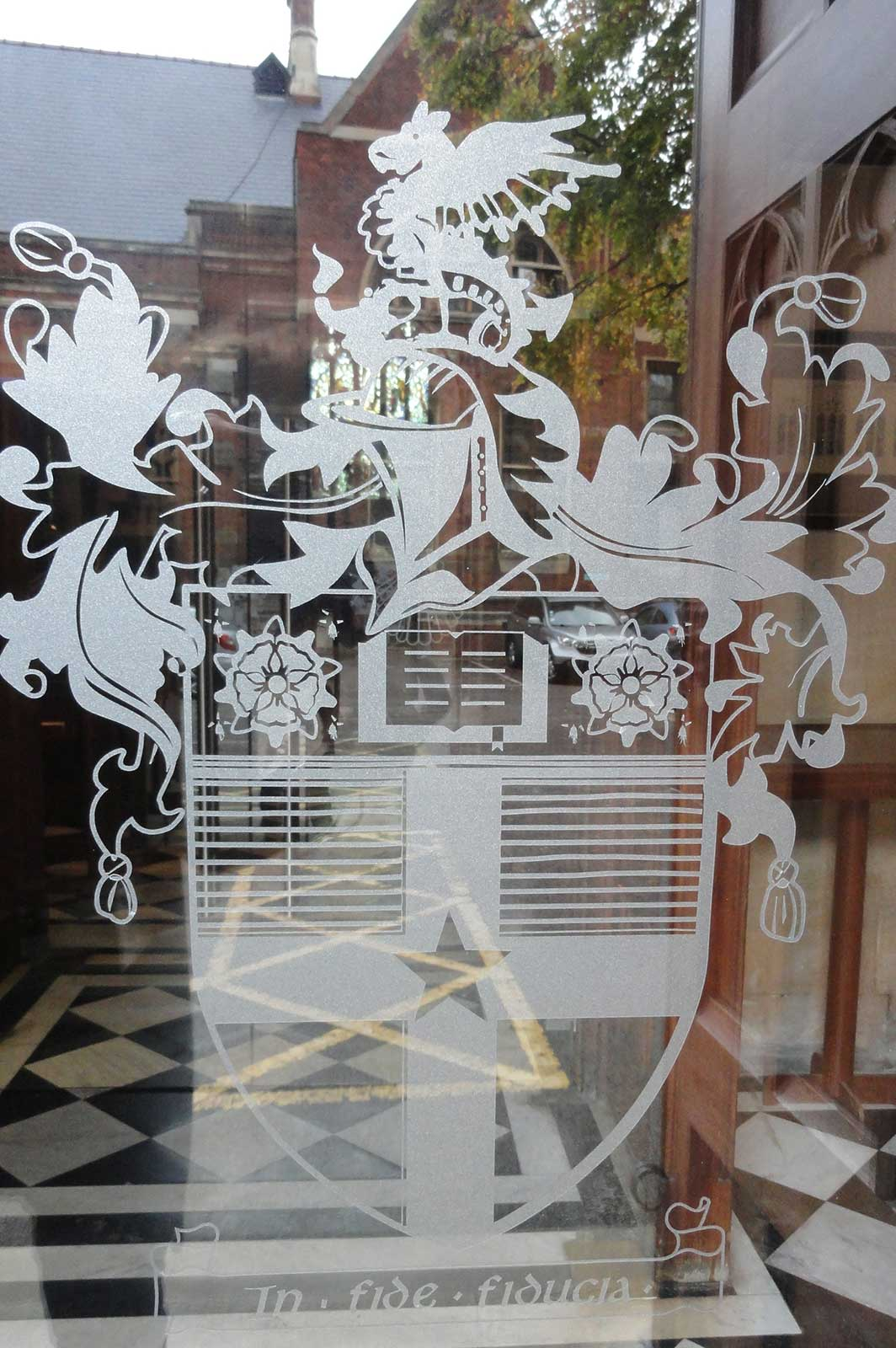 Glass Manifestation with School Crest Logo Applied to Glass Doors