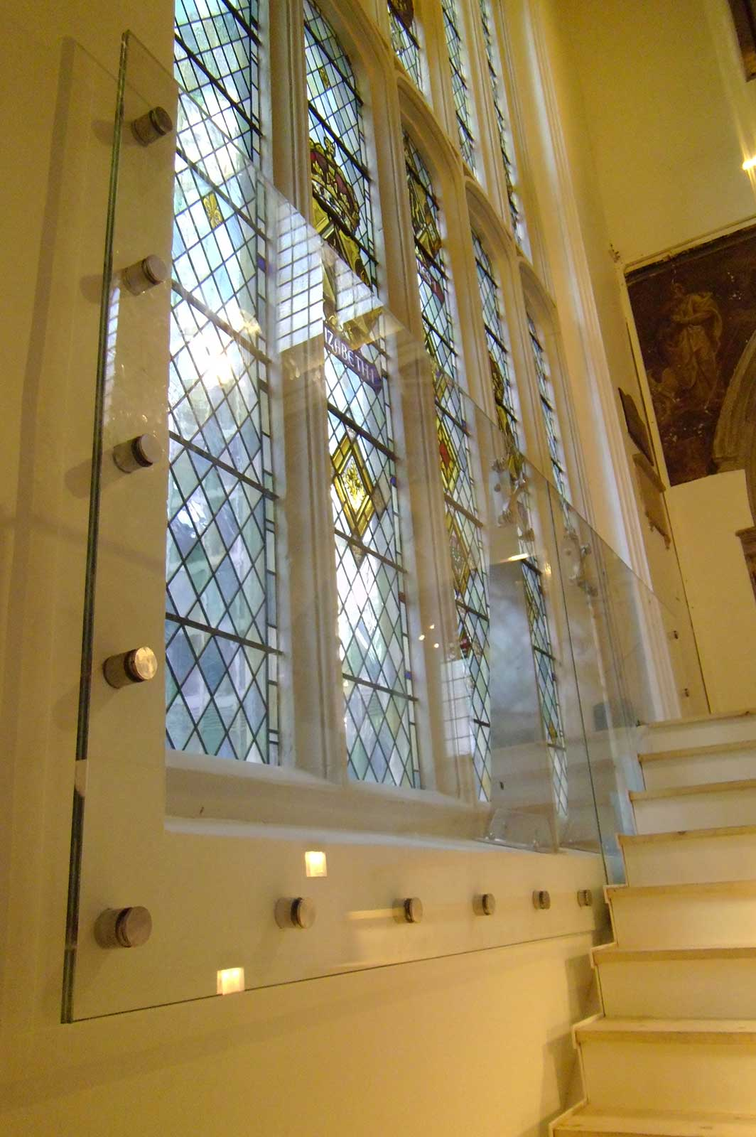 Protective glass screen for stairwell at St Andrew Undershaft