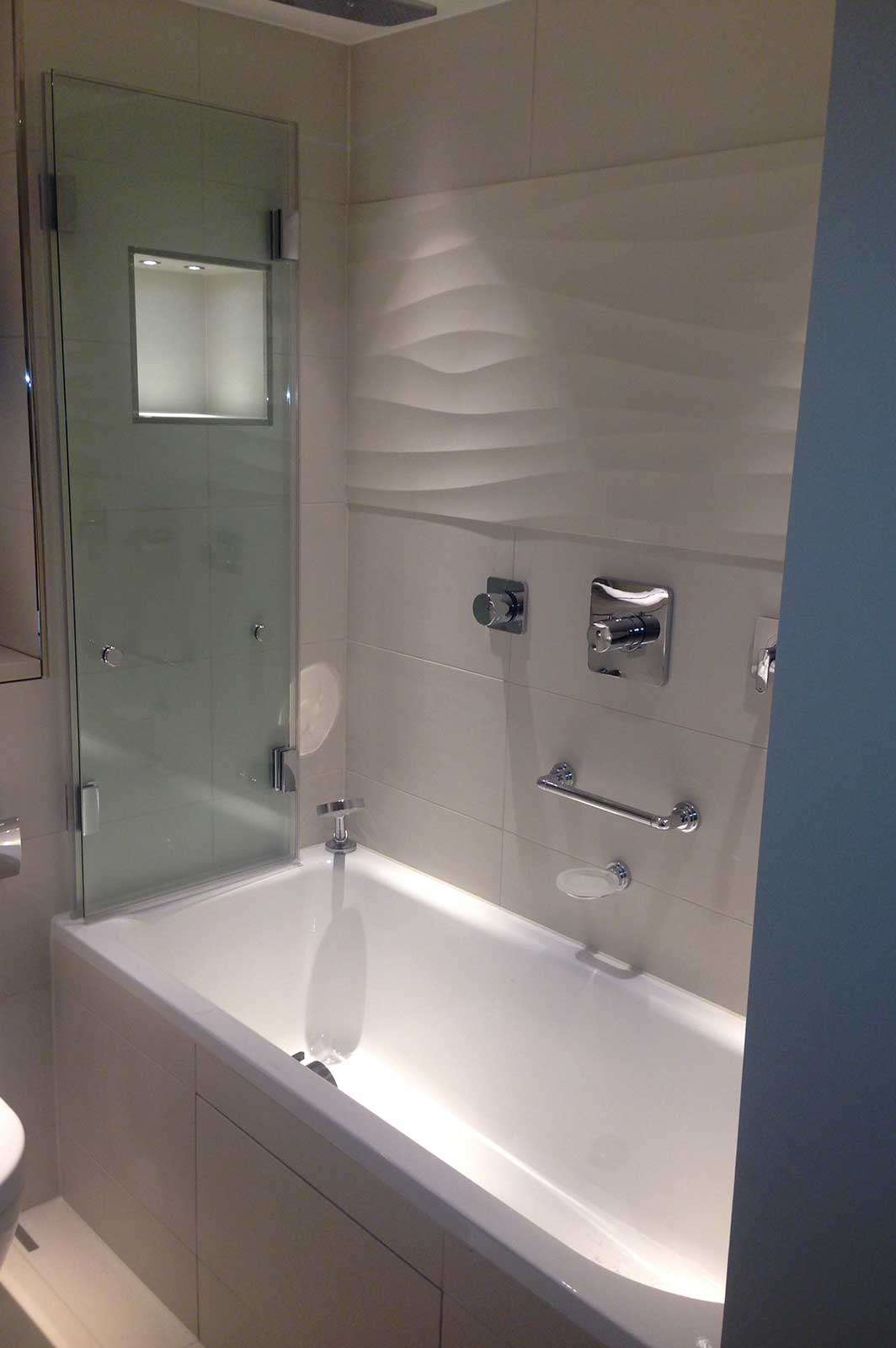 Bespoke Folding Bath Screen - Folded Flat to the Wall