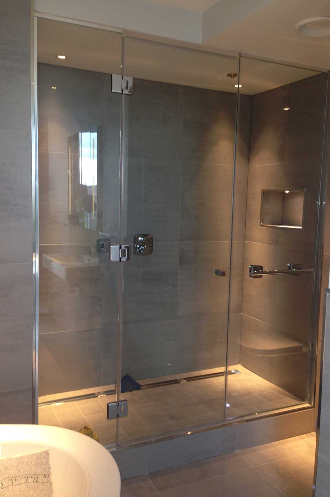 Bespoke Frameless Glass Shower Enclosure with Glass Side Panels