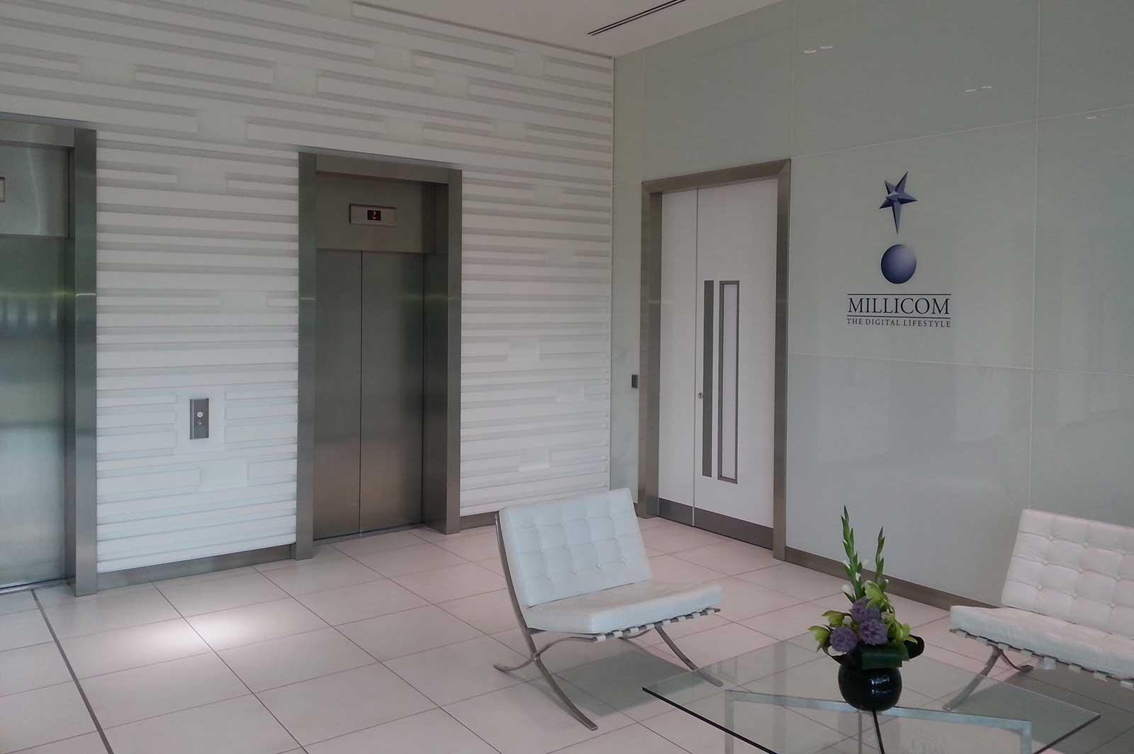 Bespoke Coloured Glass Reception Wall Cladding