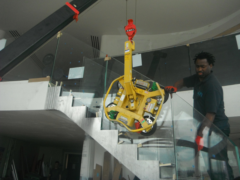 Frameless Glass Balustrade Aligned Using Spider Crane