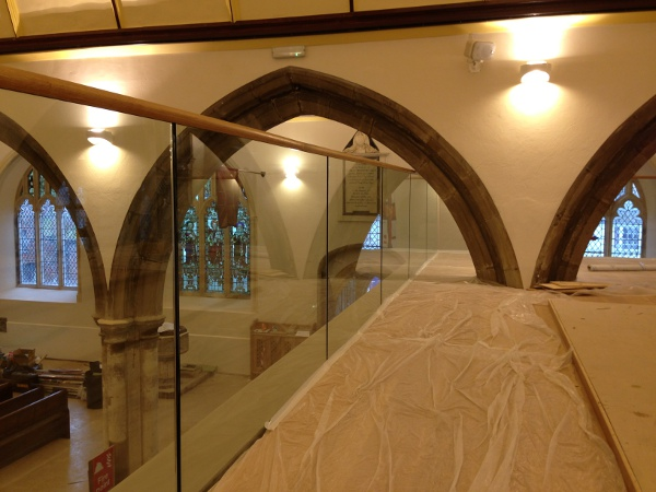Glass balustrading measured to fit under the stone arches