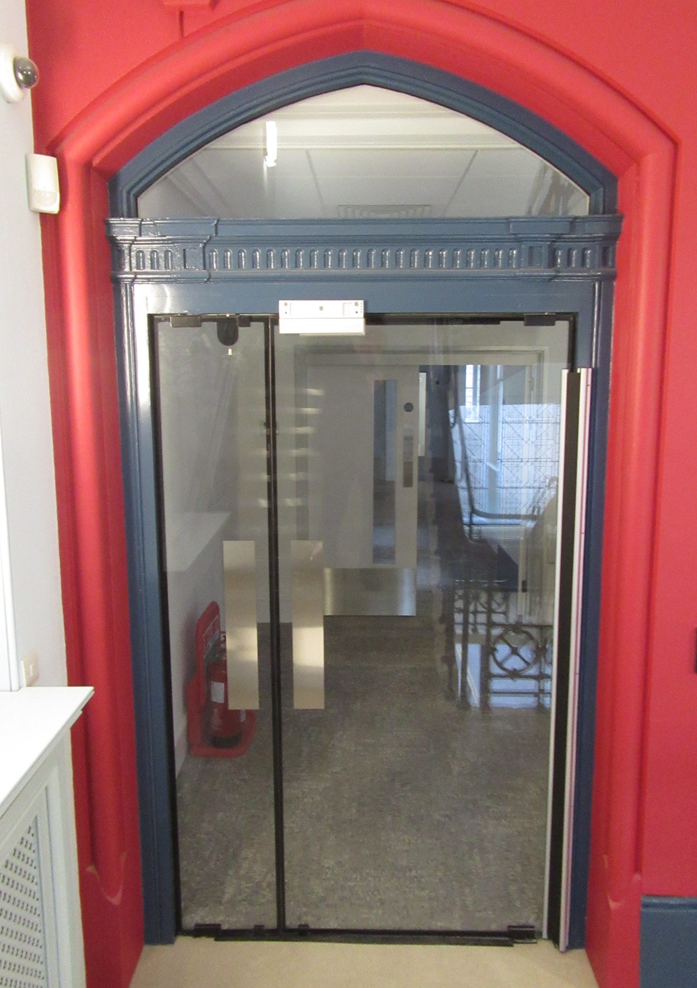 hastings-library-automatic-fire-rated-glass-door-with-arched-glass-over-panels