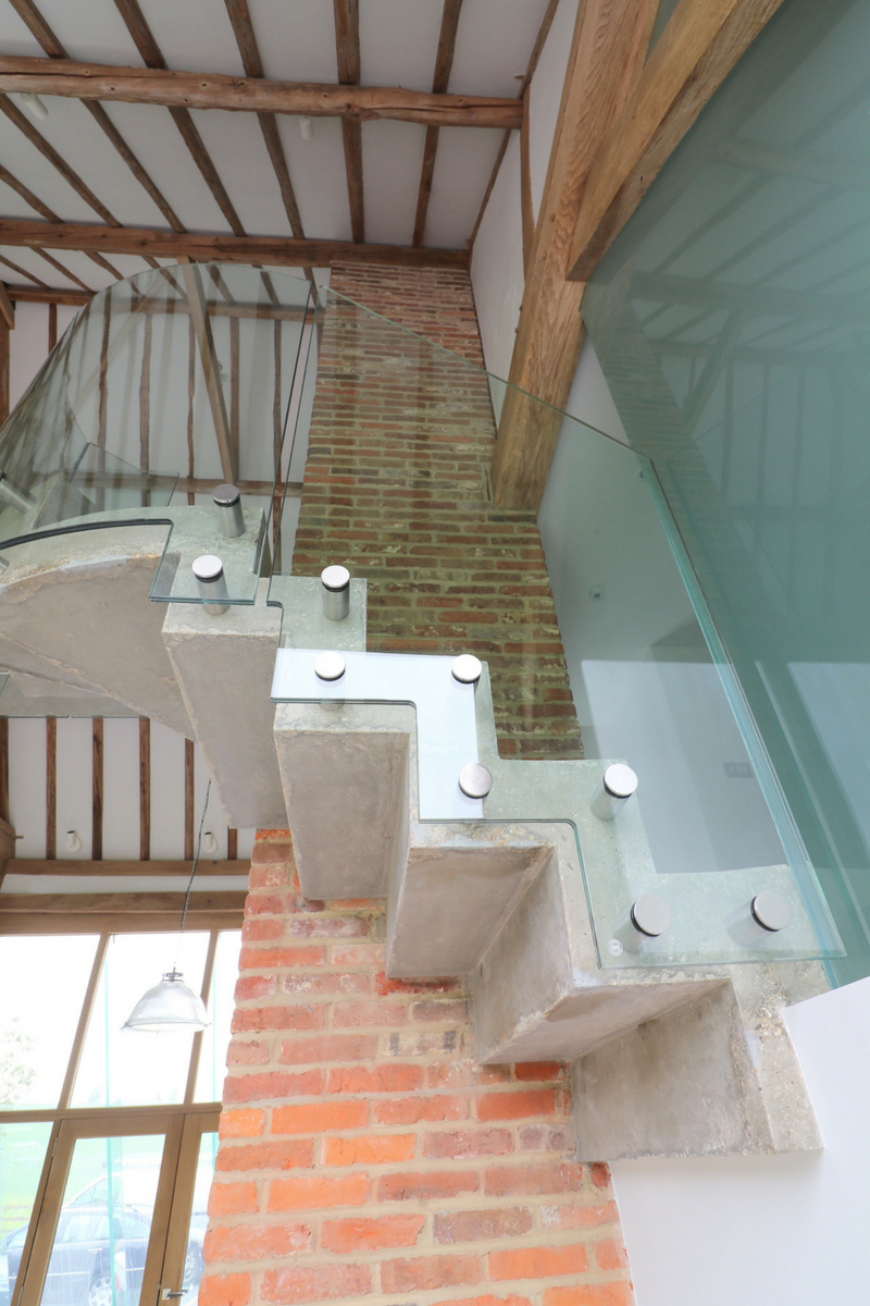 Curved Glass Balustrade Bolted To Concrete Staircase