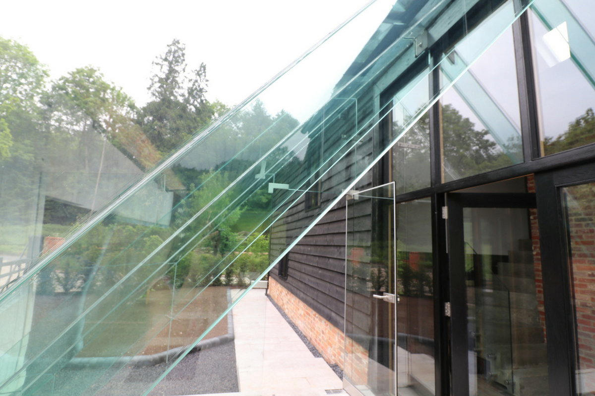 Custom Glass Porch With Structural Glass Beams