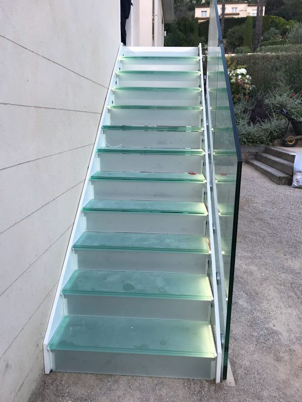Glass staircase with built in lights
