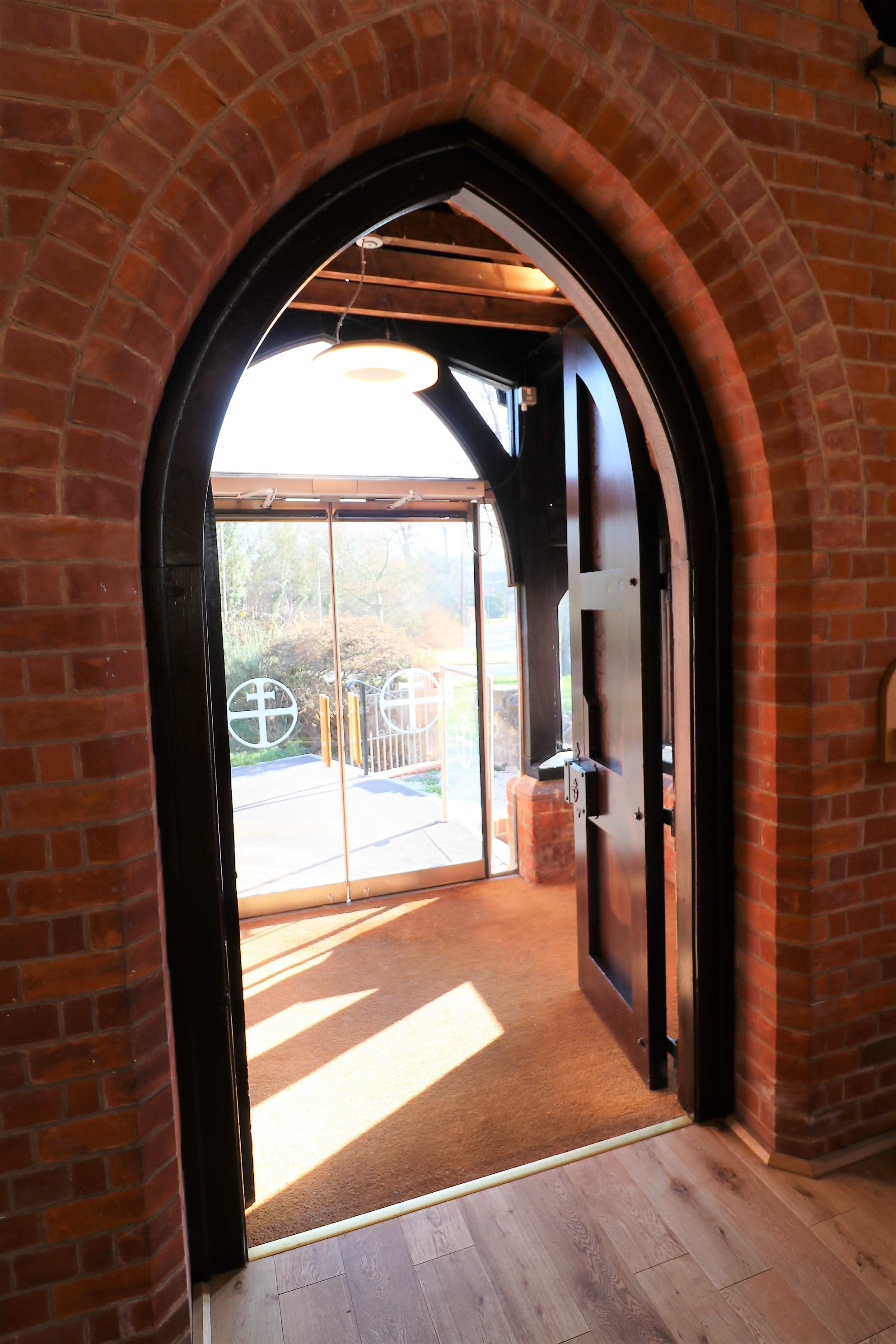 Arched interior glass doors at Holy Trinity Wantage