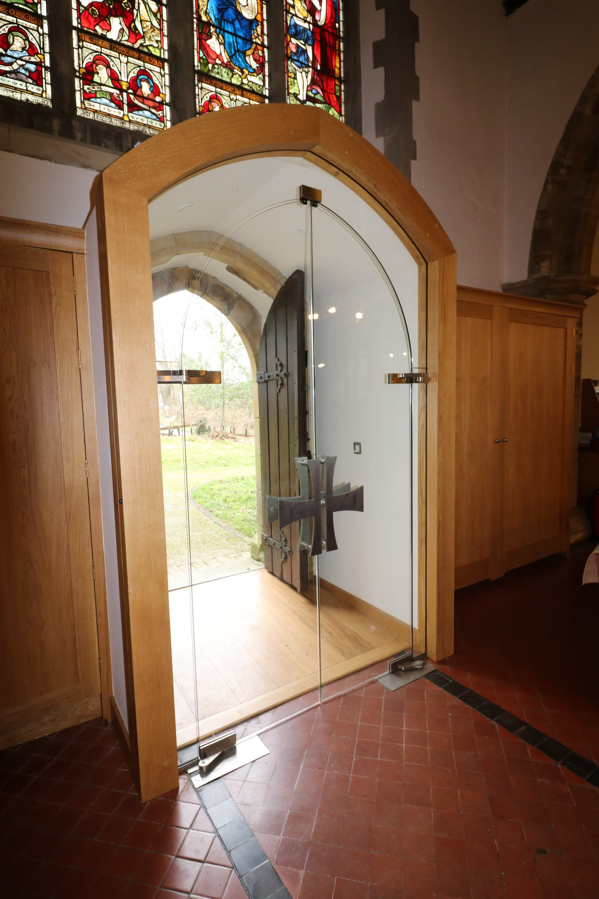 Frameless arched glass doors with custom ironmongery St Mary Balcombe