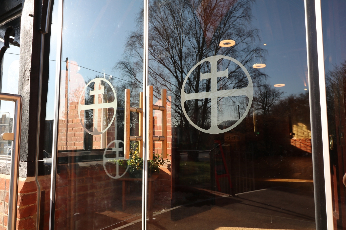 Custom manifestations for glass doors at Holy Trinity Church