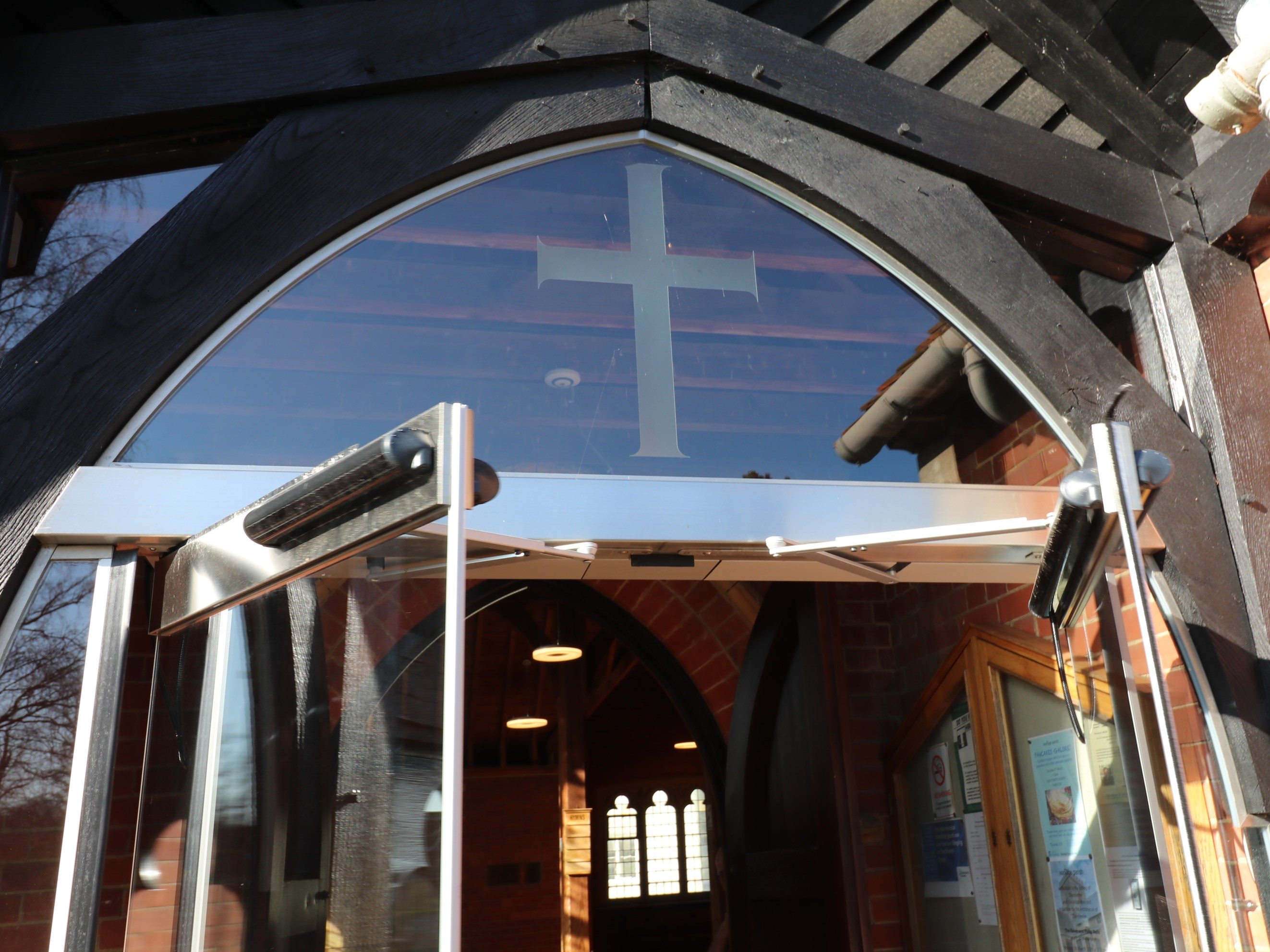 Frameless glass overpanel at Holy trinity church
