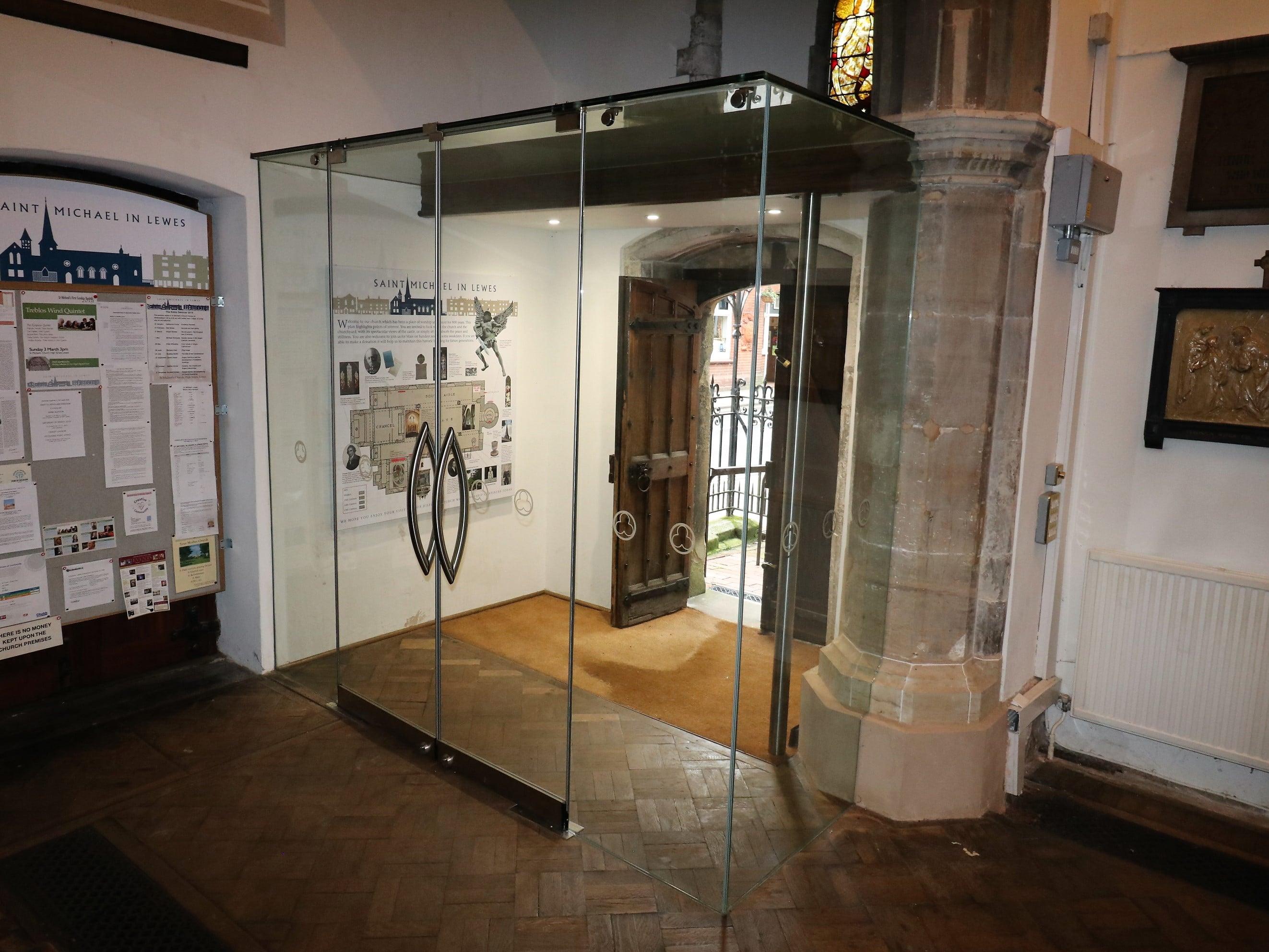 Frameless internal glass entrance lobby St Michaels church