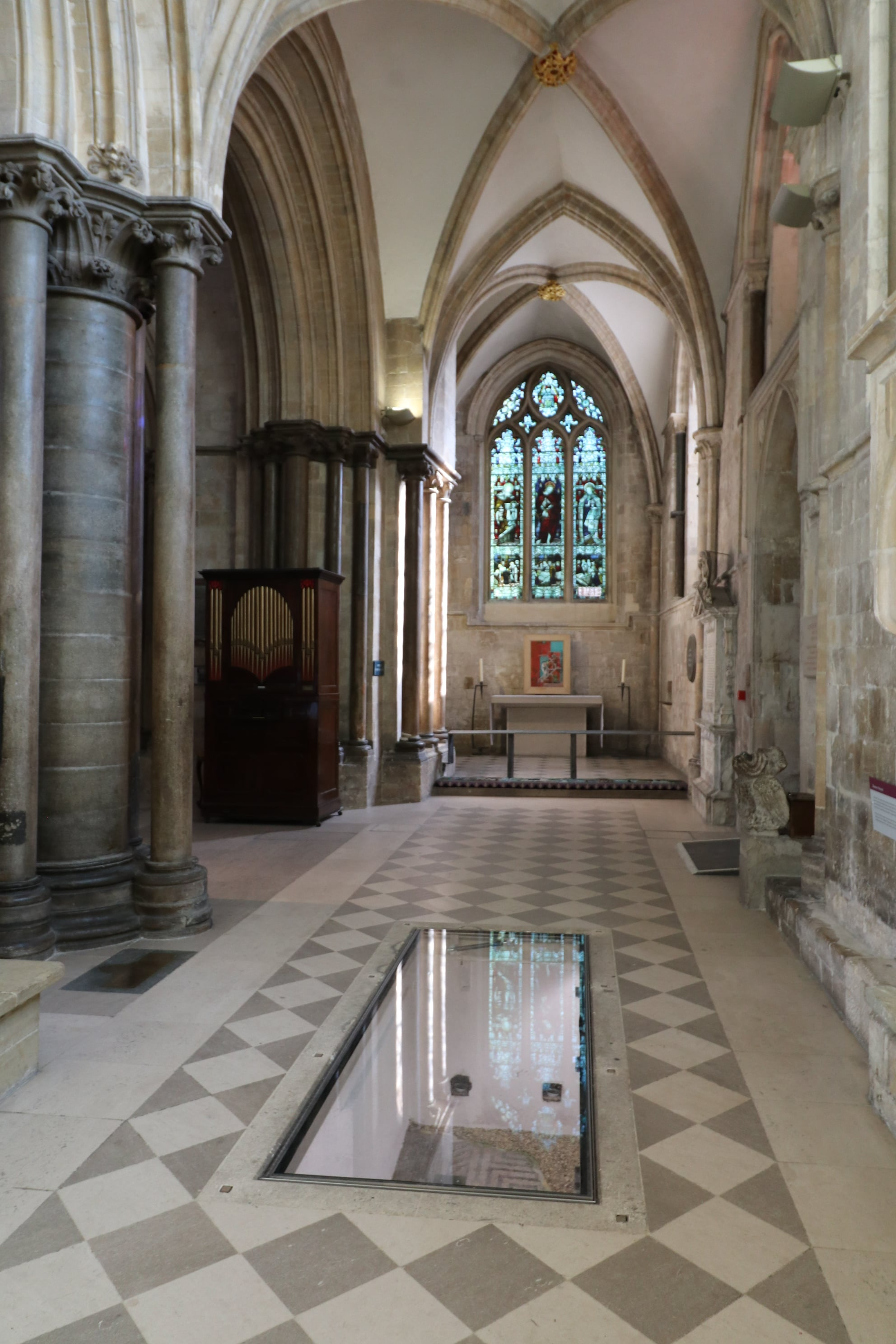 Glass floor panel to display Roman mosaic in chichester cathedral