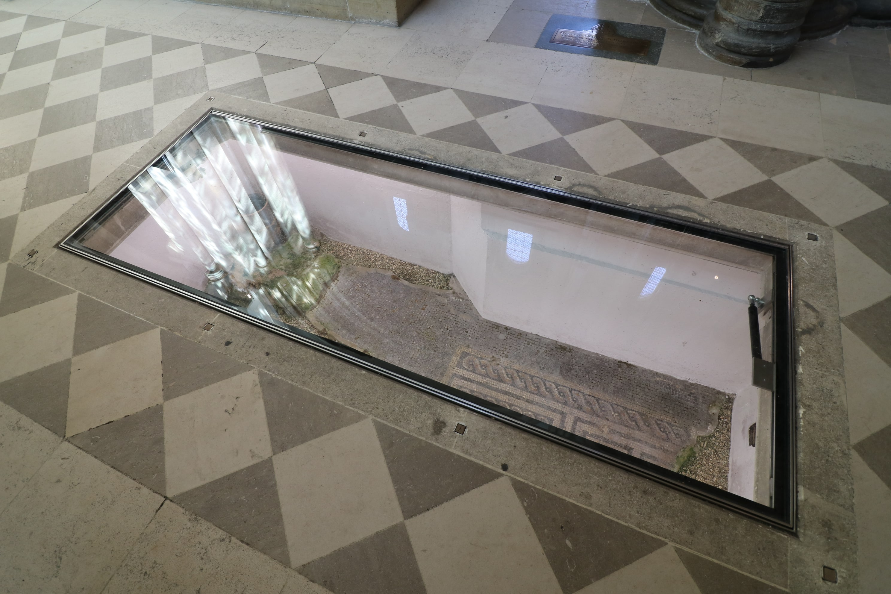 Hinged glass floor panel in Chichester Cathedral