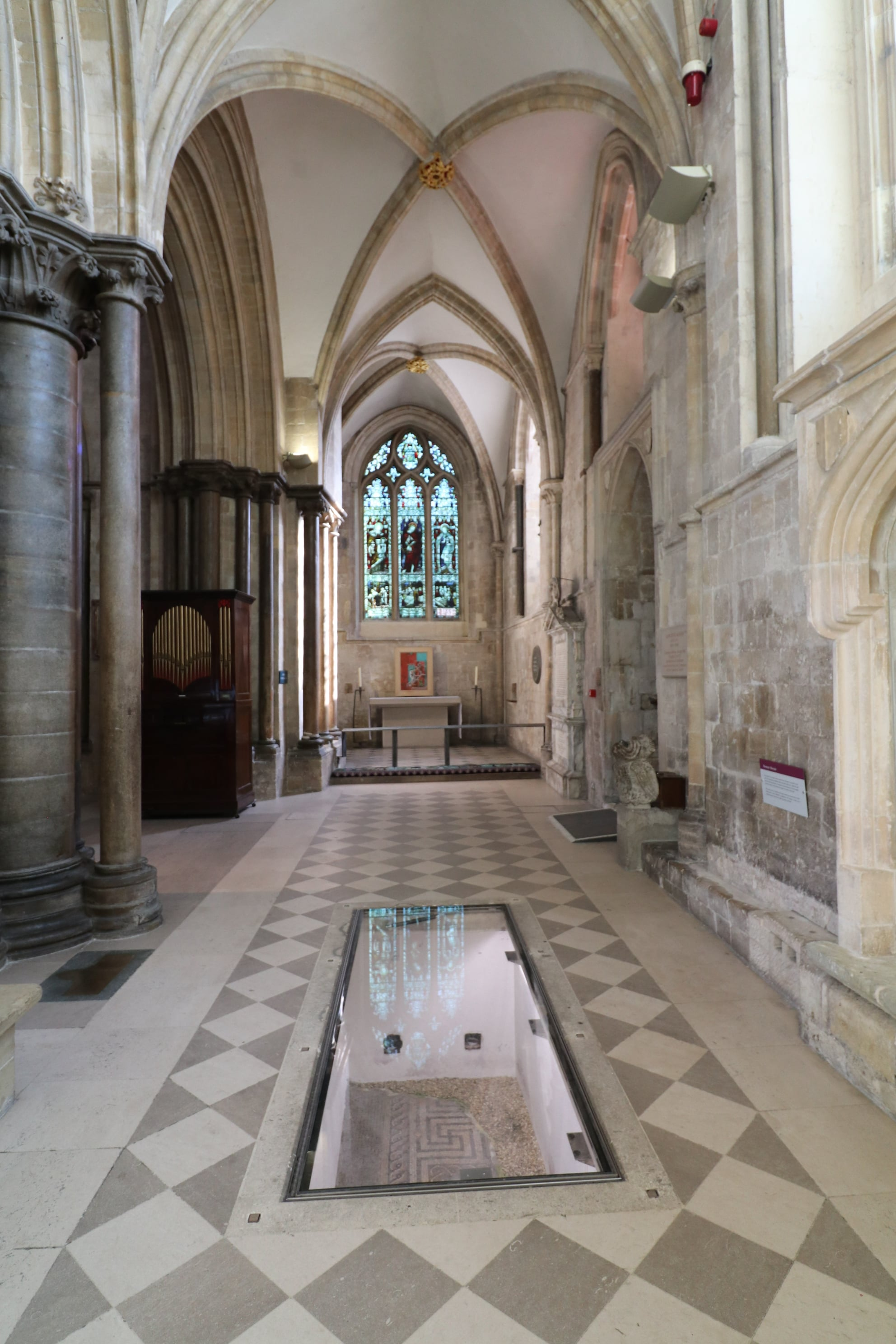 Walk on glass floor panel over Roman mosaic in chichester cathedral