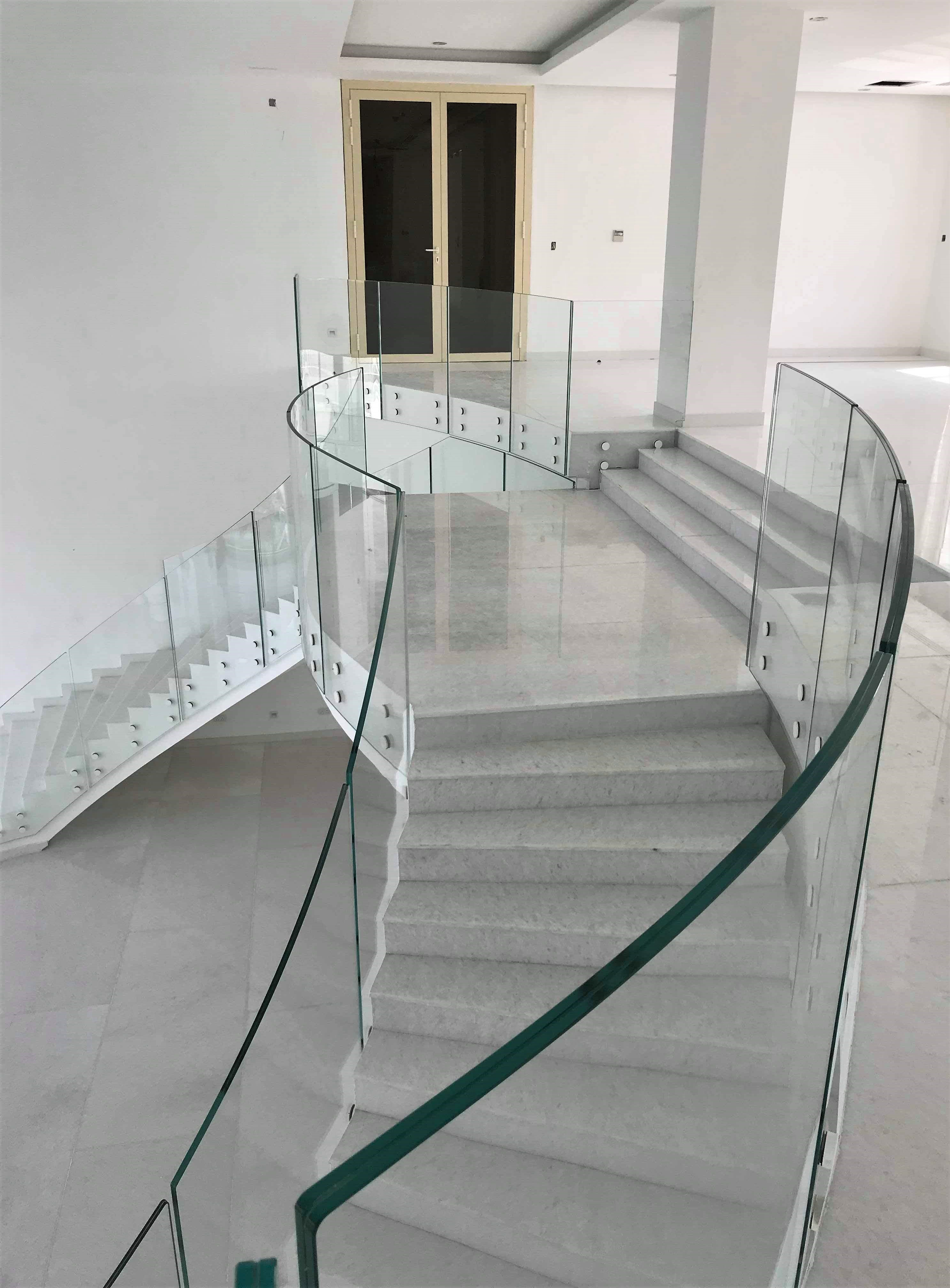 Frameless curved glass balustrade and mezzanine floor