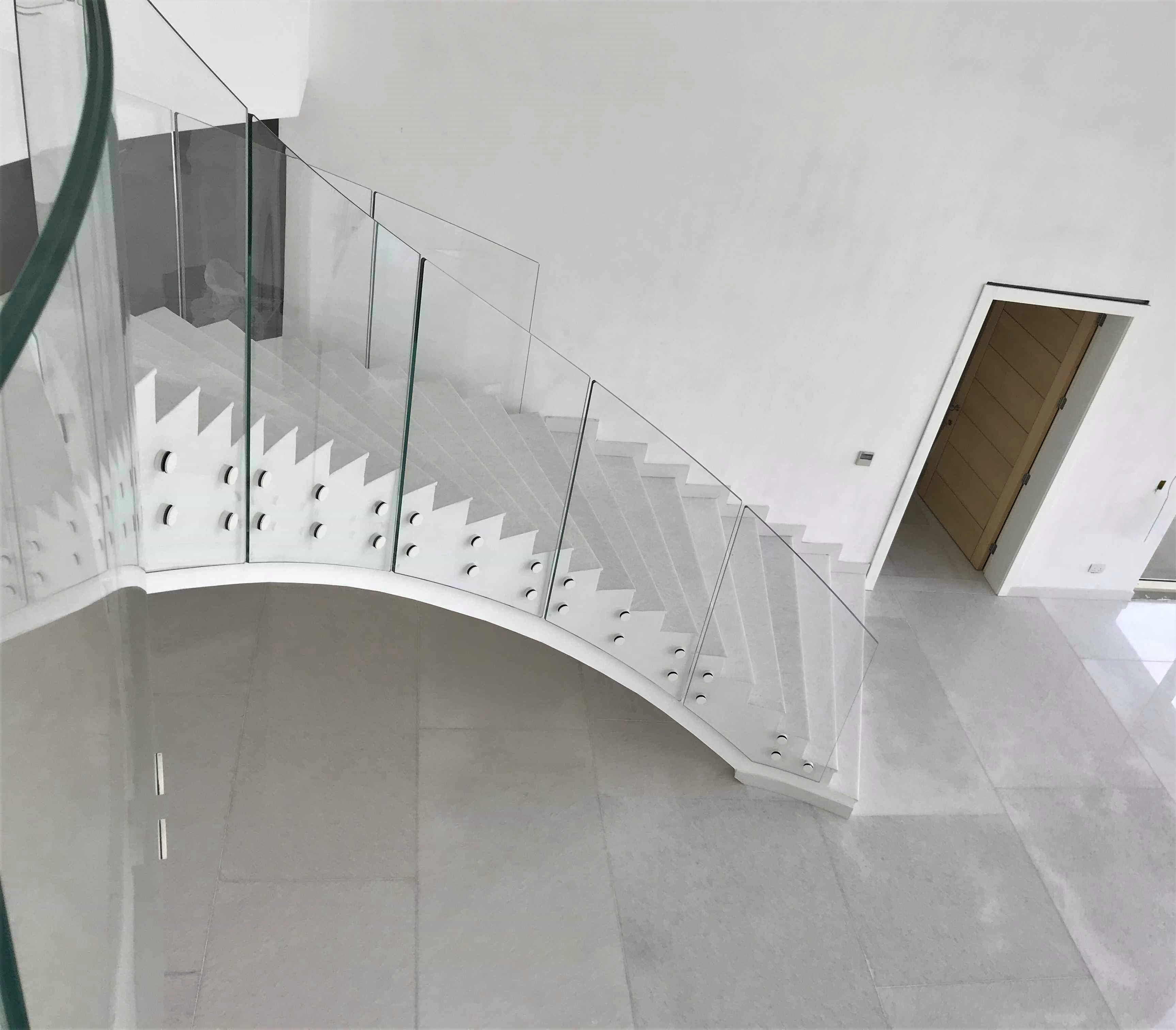 Frameless glass balustrade to double staircase