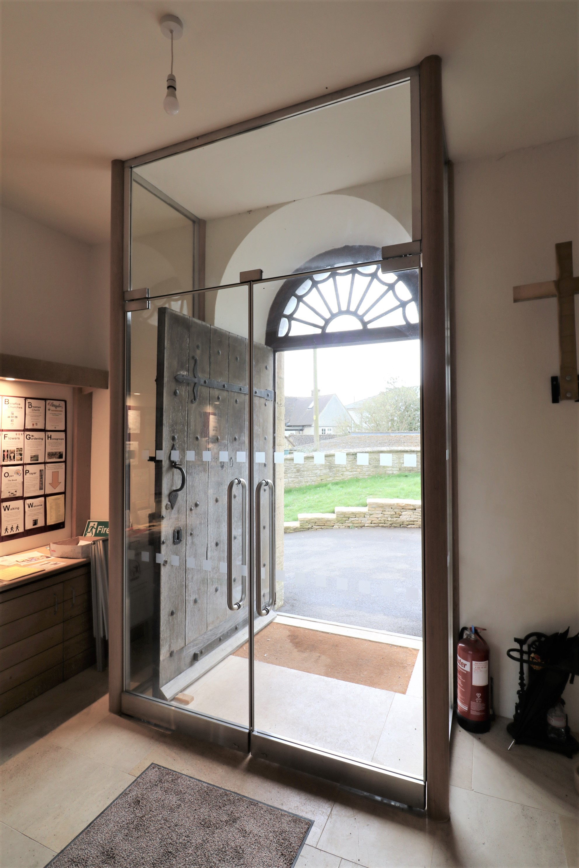 Secure glass porch with lockable double doors st-Lawrence church