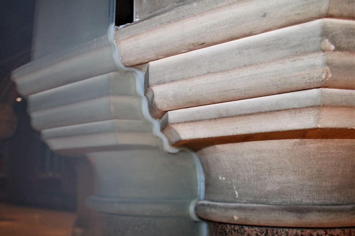 Frameless glass screen cut around pillar corbel detail at St-Dionis Church