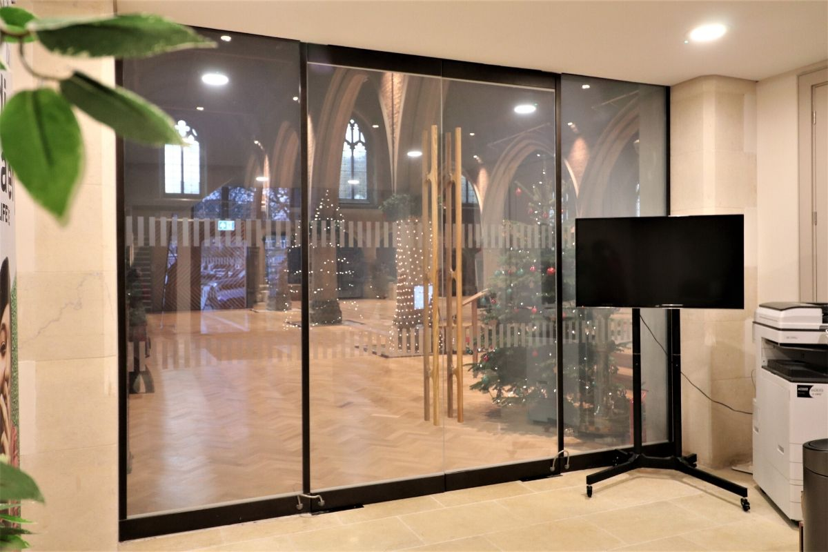 Switchable glass screen-and-doors at St Dionis Church entrance