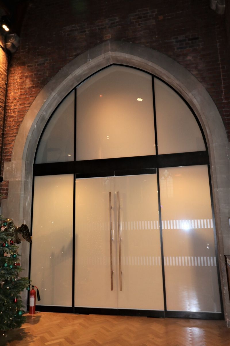 Switchable glass screen and integral doors at St Dionis Church
