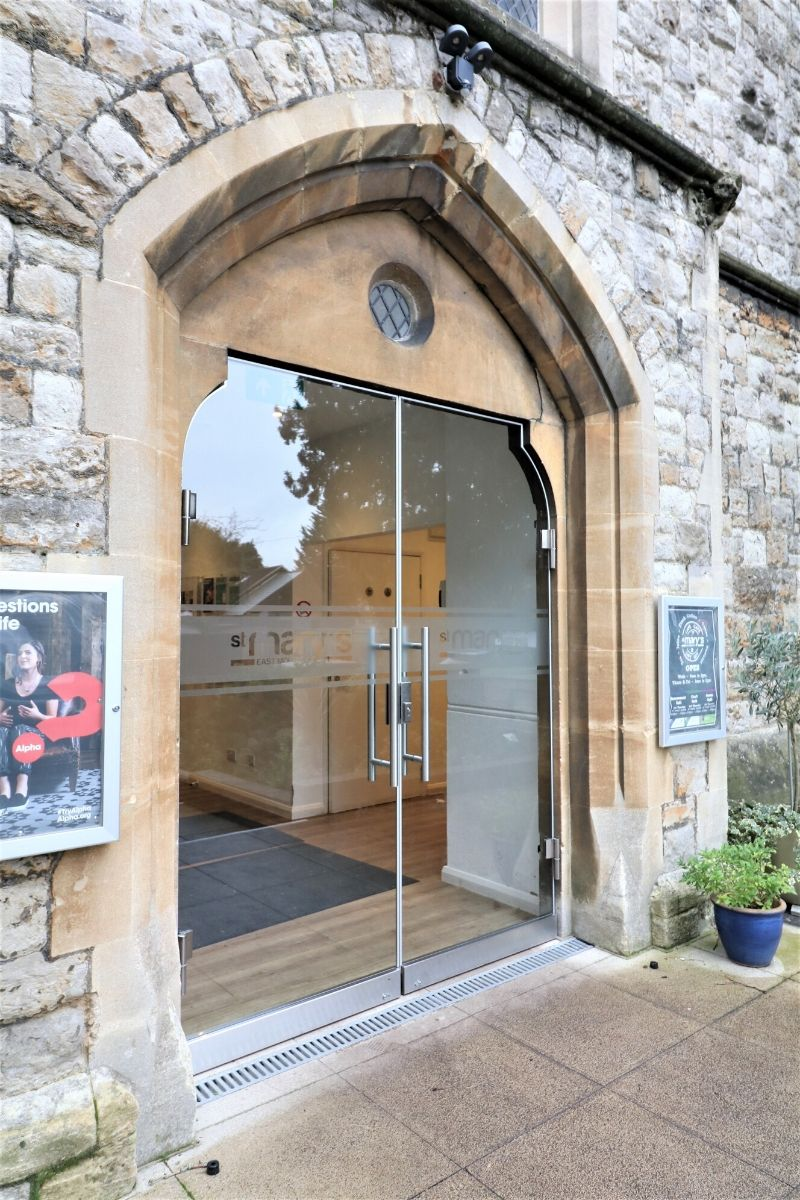 Bespoke secure external glass doors fitted to stone work, St Mary Church